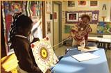 Artist Lurlynn Franklin teaches symmetry at Lincoln Elementary. - BY JUSTIN FOX BURKS