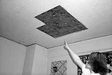 Ashley James points out the leaky ceiling in her dorm room.