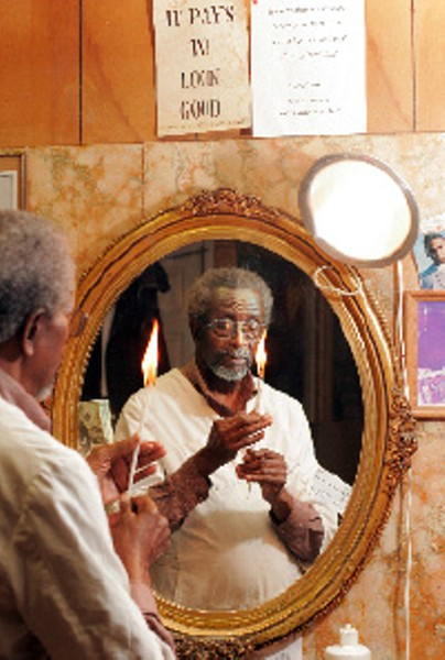 Barber and community activist Warren Lewis has been on North Thomas for 55 years. His patented hair-styling technique involves burning hair with a candle and has been featured on The Tonight Show with Jay Leno. - JUSTIN FOX BURKS