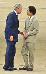 JACKSON BAKER - Before heading on the fund-raiser for Lamar Alexander, Bush jawed on the Tennessee Air National Guard airstrip with White Station High School student Chi Zhang, winner of a presidential Volunteer Service Award.