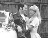 Ben Hensley as Danny and Lisa McCormick as Sandy in Grease.