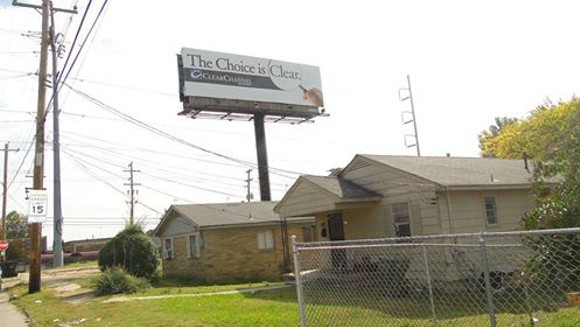 Residents think this billboard close to Ayers Street was built illegally and should be removed. - MARY BAKER