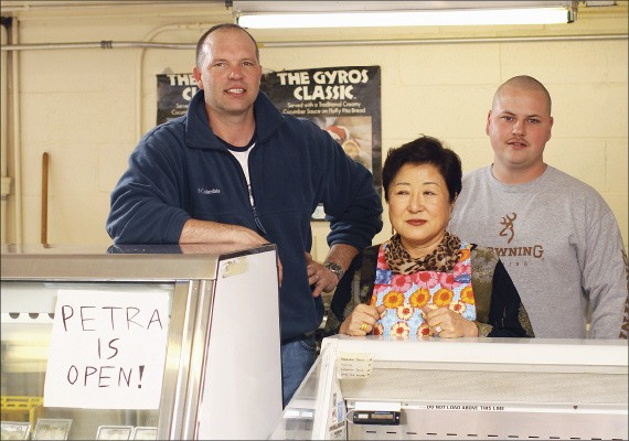 Brad Wilbanks, left, with mother-in-law Ok Lon Kim and nephew Jason Wilbanks