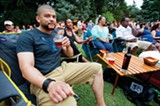 Brian Sanders enjoys a cold drink along with (from left) Elaina Norman, Patricia Duckett, and Kim Duckett as they watch Cedric Burnside Project perform during the free summer concert series at the Levitt Shell in Overton Park. - BRANDON DILL