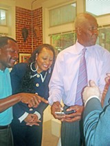 JB - Calvin Anderson and Gale Jones Carson admired Mayor Herenton's new iPhone at last week's fundraiser for county commissioner Deidre Malone.