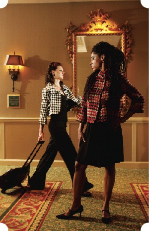 Checks and Balances. - From left: Tulle houndstooth check - crop jacket, $88, from Lansky 126, with black trousers (models own). Miss me red plaid jacket, $115, from Muse, with black R. Jean dress, $128, from Lansky 126. - JUSTIN FOX BURKS