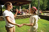 Childbirth educator Sarah Stockwell (left) talks with Mary Beth Best of Birth Works Doula Services during an event at Overton Park benefiting Postpartum Progress, a nonprofit that supports new mothers with mood or anxiety disorders. - BRANDON DILL