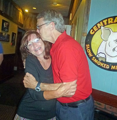 Chris Caldwell, winner in a tight three-way race for the District  1 seat on the Unified School Board, bestows a celebration kiss on wife Cheryl.