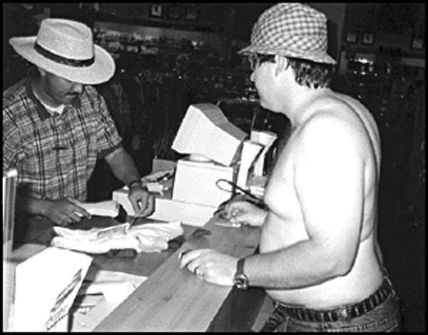 "Chris Davis as ""Shirtless Man"" attempting to buy a shirt at Sears - DAN BALL"