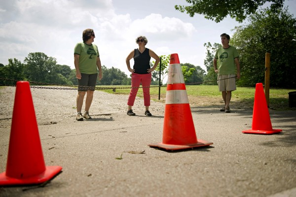 Citizens to Preserve Overton Park members (from left) Naomi Van Tol, Stacey Greenberg, and Roy Barnes stand on part of the contested area of the park's Greensward used for overflow parking by the Memphis Zoo. - BRANDON DILL
