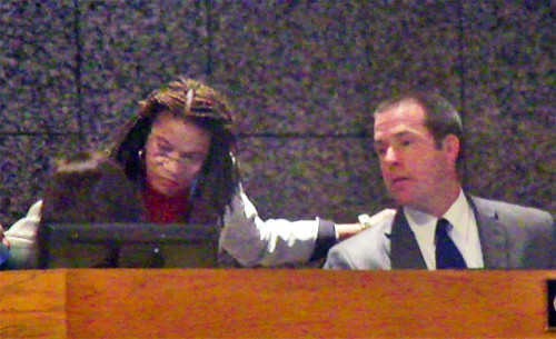 Commissioners Henri Brtooks and Wyatt Bunker get technical counsel from Commission parliamentarian Kristi Kinard (recessed at left)