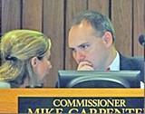 JB - Commissioners Shafer (l) and Carpenter confer.