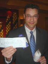 Demcoratic chairman Kuhn with Gibbons' voided check. - JB