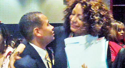 Democratic chairmanship candidate Terry Spicer and Gale Jones Carson, mother of his rival, Bryan Carson, hug on Saturday.