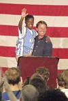"""Democratic presidential hopeful John Edwards hoisted Cody, a young supporter, during Edwards' Monday night appearance at the MIFA Thrift Store in Memphis, where he concluded the first day of his three-day """"Road to One America"""" tour."""