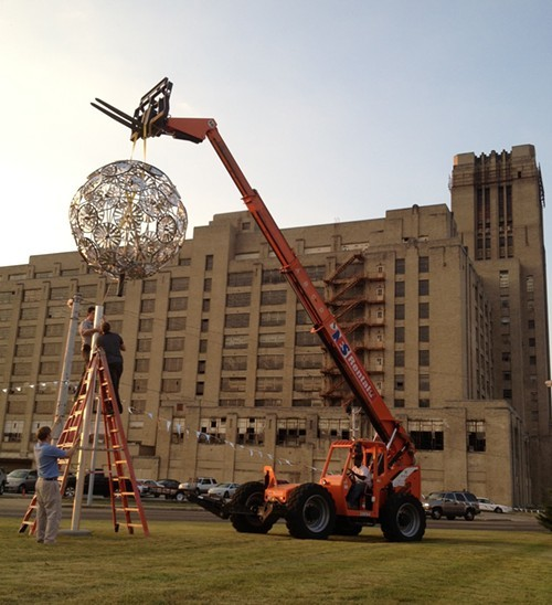 Eli Gold and Colin Kidder install their Beacon sculpture.
