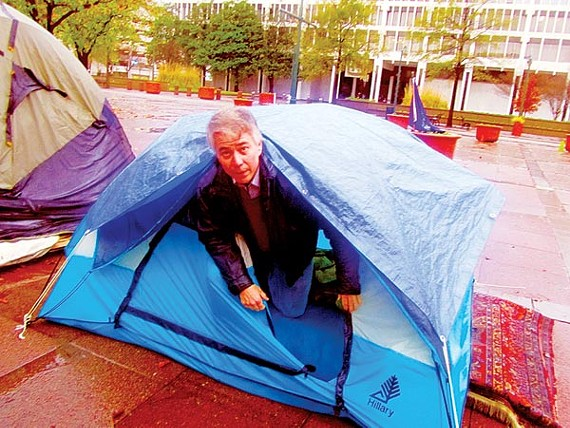 Emerging from his tent Tuesday morning at the Occupy Memphis encampment on the downtown mall is Shelby County commissioner Steve Mulroy, who spent a rain-soaked evening there in solidarity with the protesters.
