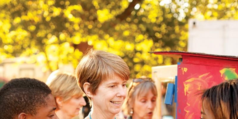 The Hamp Erin Harris, below left, with kids at the Carpenter Art Garden in Binghampton Justin Fox Burks