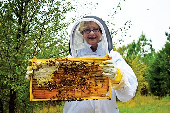 Eyleen Farmer with some of the bees from Friends of Thistle Farms