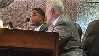 Ford affirms his support for Luttrell's tax rate as Basar listens.