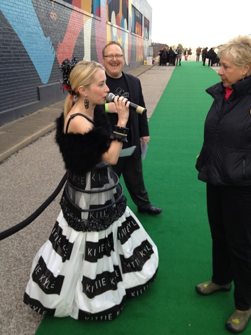 Former American Idol contender Alexis Grace welcomes guests in a recycled dress.