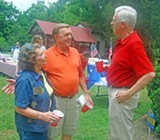 JB - Gibbns (right), talks things over with fellow picknickers Freddie Ashley-Smith and Circuit Court Clerk Jimmy Moore.