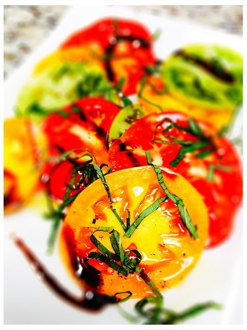 Heirloom Tomatoes with basil, olive oil, and a balsamic reduction