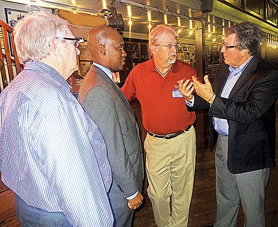 Hitting the Stretch: State representative Craig Fitzhugh (far right) of Ripley, the Democrats' House leader and candidate for reelection, discussed strategy with Memphis Democrats Ed Smith, Van Turner, and Bobby Sproles at a recent fundraiser. Smith and Sproles are union officials; Turner is local Democratic chairman.