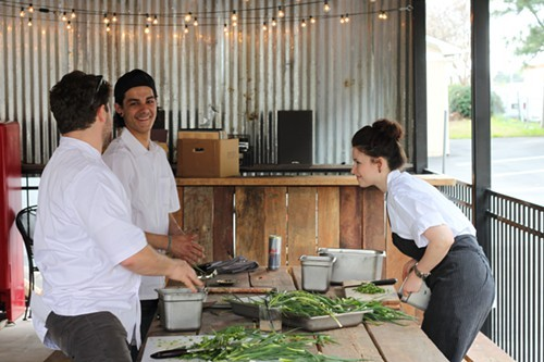 Hog & Hominy staff preparing for chefs meal after Beard dinner. H&H is converting its back patio, shown here, into a dive bar.