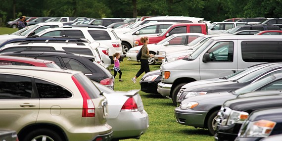 In this file photo from 2013, overflow parking from the Memphis Zoo covers a large portion of the Greensward at Overton Park.