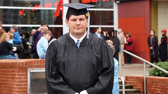 Iraq war veteran Charles Cooper graduates from the University of Memphis.