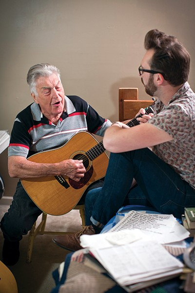 James Wesley Cannon plays a tune for his grandson, Joshua Cannon - JUSTIN FOX BURKS