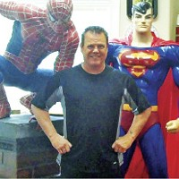 """Jerry Lawler and campaign """"volunteers"""": his personal statues of Spiderman and Superman"""
