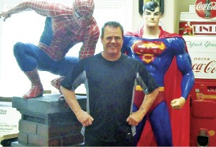 """Jerry Lawler and campaign """"volunteers"""": his personal statues of Spiderman and Superman - JACKSON BAKER"""