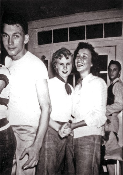 Jim Cannon (left), Jean Jennings (middle left), Johnny Black's wife Carolyn (middle right) and Elvis (right) mingle at a party at Cannon's mother's house on Colby Street. - COURTESY CANNON FAMILY