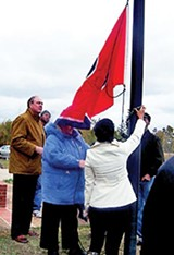 Jim Kyle presides over the flag-raising at the Frayser Vietnam Memorial last week.