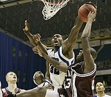 AP PHOTO - Joey Dorsey, with one of the Tigers' six blocks.