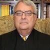 Judge To Decide on School Merger