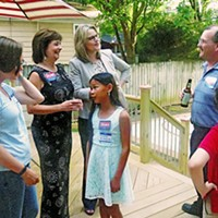 Center of Attention Judicial candidate Leah Roen with supporters at outdoor fundraiser JB