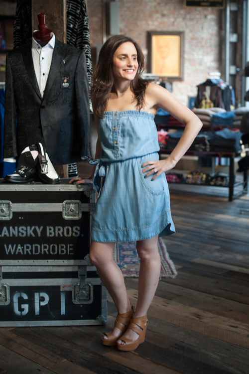 Julie wears a dress and shoes from Lansky 126.