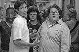 Justin Long and Jonah Hill (foreground, left and right) can't stop looking at the films and characters of the past.