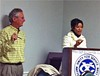 Kemba Ford, here with Frayser Exchange Club president Shelly Rice, answers constituents' questoins.