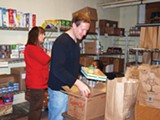 Kevin Nowlin volunteering with - Catholic Charities of West Tennessee