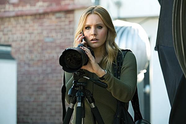 Kristen Bell as Veronica Mars, with her ubiquitous telephoto lens.