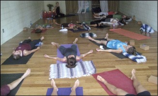 Kundalini yoga students relax after class.