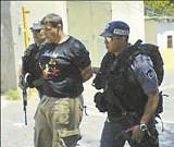Kyle Kordsmeier under arrest ouside the U.S. Consulate in East Jerusalem.