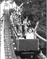Less than a year later, the troubled municipal amusement park was taken over by Elvis Presley Enterprises and renamed Graceland Fairgrounds. Presley, seated front, rides the Zippin Pippin to celebrate the reopening.