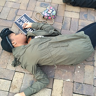 "Locals Hold ""Die-In"" In Solidarity With Victims of Police Shootings"