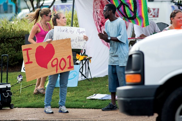 """""""Love Mob"""" gathers at Poplar and Highland in response to Kroger parking lot beating. - JUSTIN FOX BURKS"""