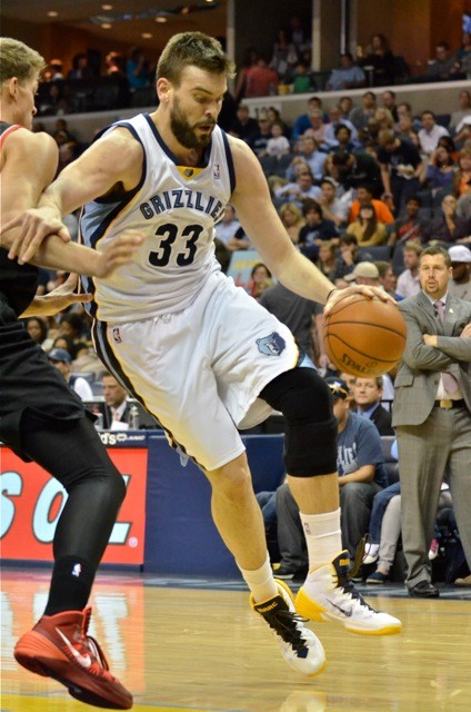 Marc Gasol drives past a guy with two last names.